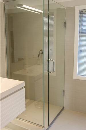 Glass-to-wall hinge 8mm frameless glass shower designed to fit this awkward space, finished with a double D handle